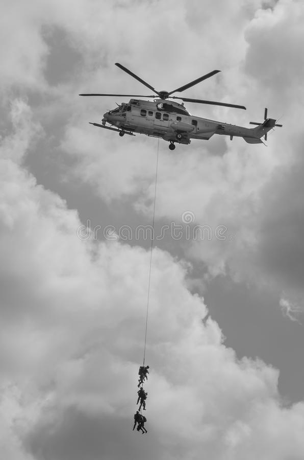 Air show Helicopter in action. Air show Radom military Helicopter in action with marines Army royalty free stock images