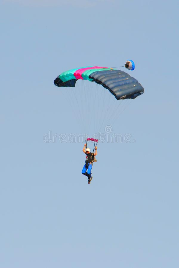 Air show. Man in a parachute at the Swartkop air show in Pretoria, South Africa stock image