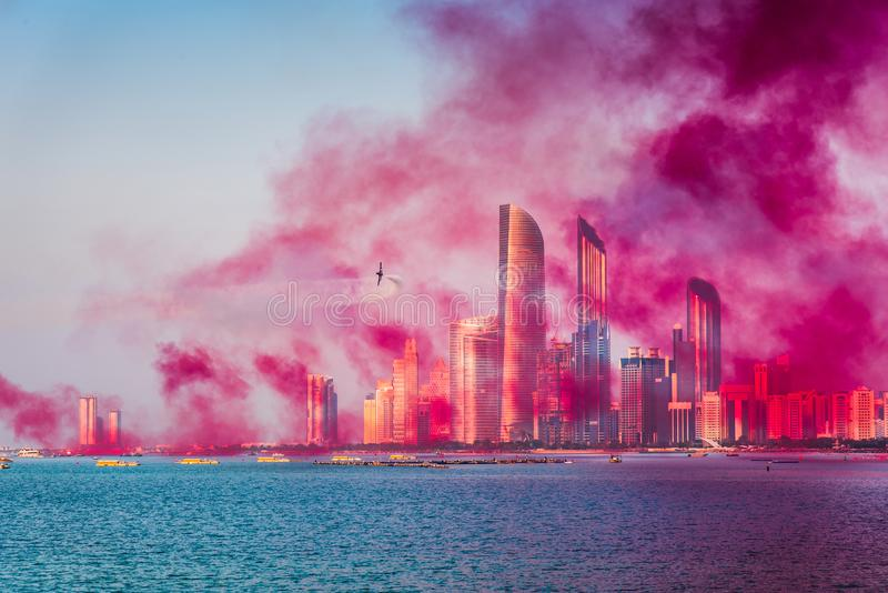 Air show over Abu Dhabi skyline for the UAE national day celebration. Air show over Abu Dhabi skyline for the United Arab Emirates national day celebration, uae stock image