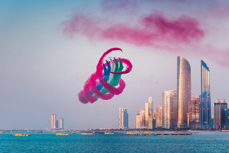 Air show over Abu Dhabi skyline for the UAE national day celebration. Air show over Abu Dhabi skyline for the United Arab Emirates national day celebration, uae stock images