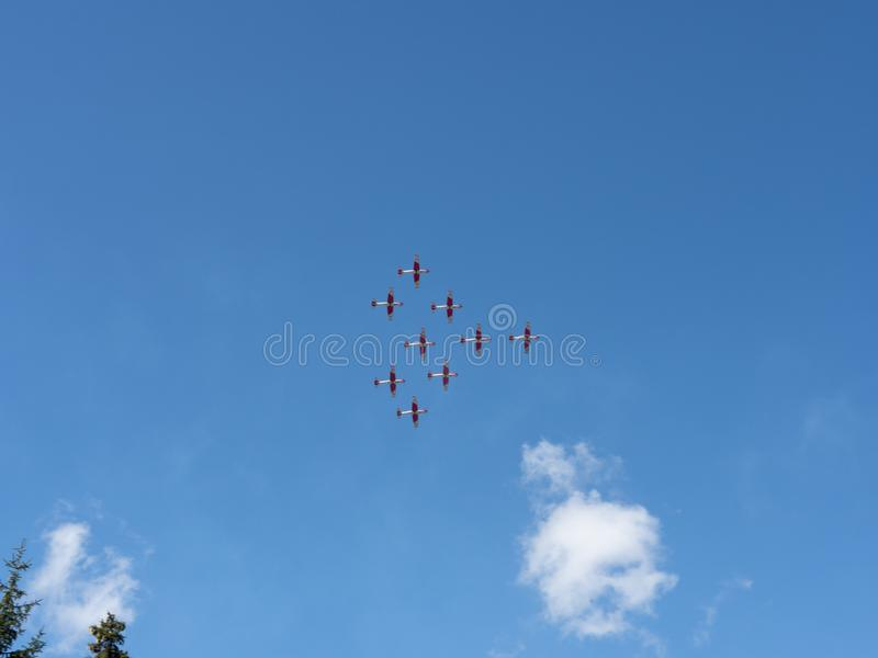 Air show of the Patrouille Suisse on the Swiss alps stock photos