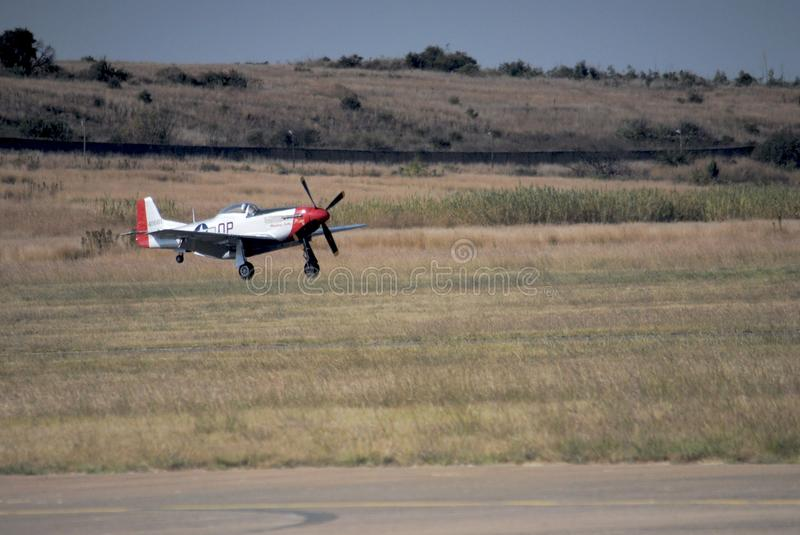 Air show. Plane landing on the grass at the Swartkop air show in Pretoria, South Africa royalty free stock photos