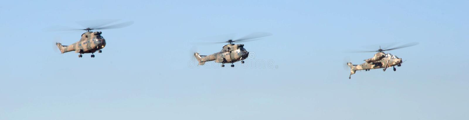 Air show. Three helecopter fly past at the Swartkop air show in Pretoria, South Africa royalty free stock photography