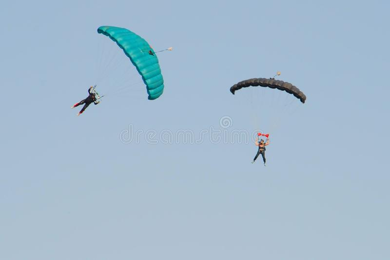 Air show. Two man parachute team at the Swartkop air show in Pretoria, South Africa royalty free stock photo