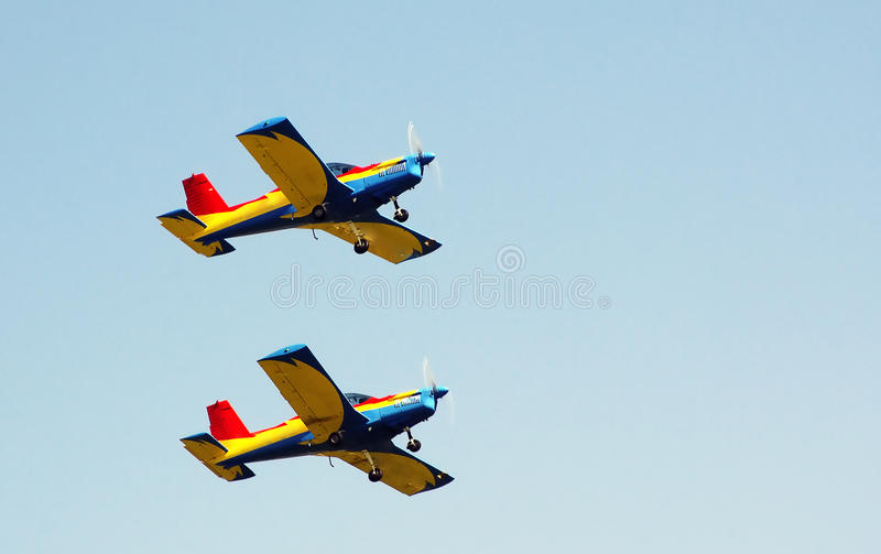 Air show. Two small airplanes in flight during air show royalty free stock photography