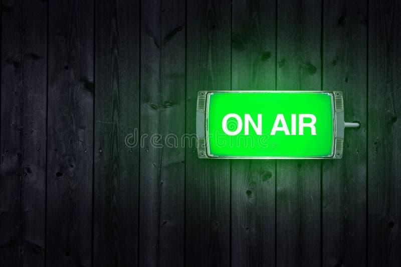 On air sign. Green illuminated radio station signage stock photos