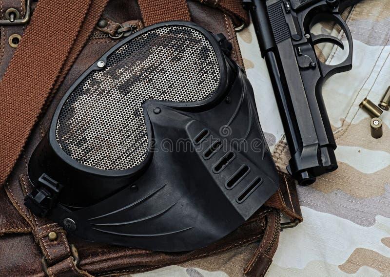 Air-soft gun and mask. stock image