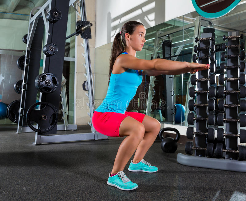 Air squat woman exercise at gym. Air squat woman workout exercise at gym stock image