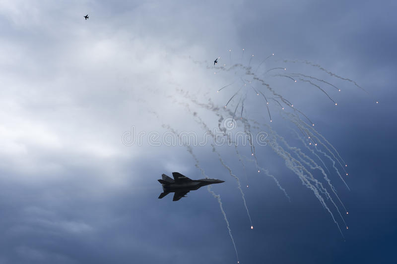 Air Strike. Fighter Jet in Dogfight. Aircraft in Battle Firing Defense Flares. War Zone. Air Strike. Fighter Jet in Dogfight. Aircraft in Battle Firing Defense stock images