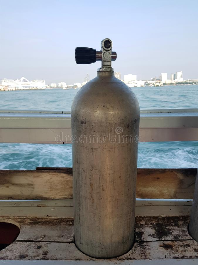Air tank in a slot for SCUBA divers on the boat stock images