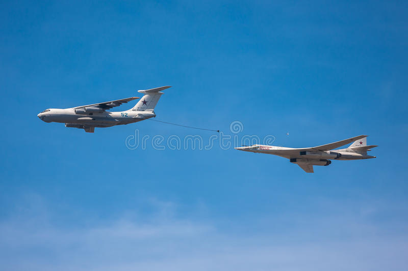 Air tanker and Tu-160 strategic bomber imitate mid-air refueling during the parade. MOSCOW - MAY 09: Il-78 air tanker and Tu-160 strategic bomber imitate mid-air royalty free stock images
