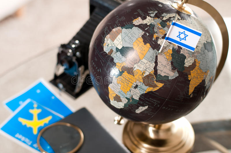 Air ticket and Israeli flag on globe. Travel. Air ticket and Israeli flag on globe stock images