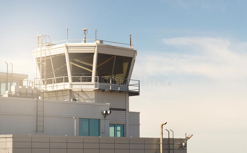 Air traffic control building and tower in a small airport. Old vintage and retro filter look royalty free stock image