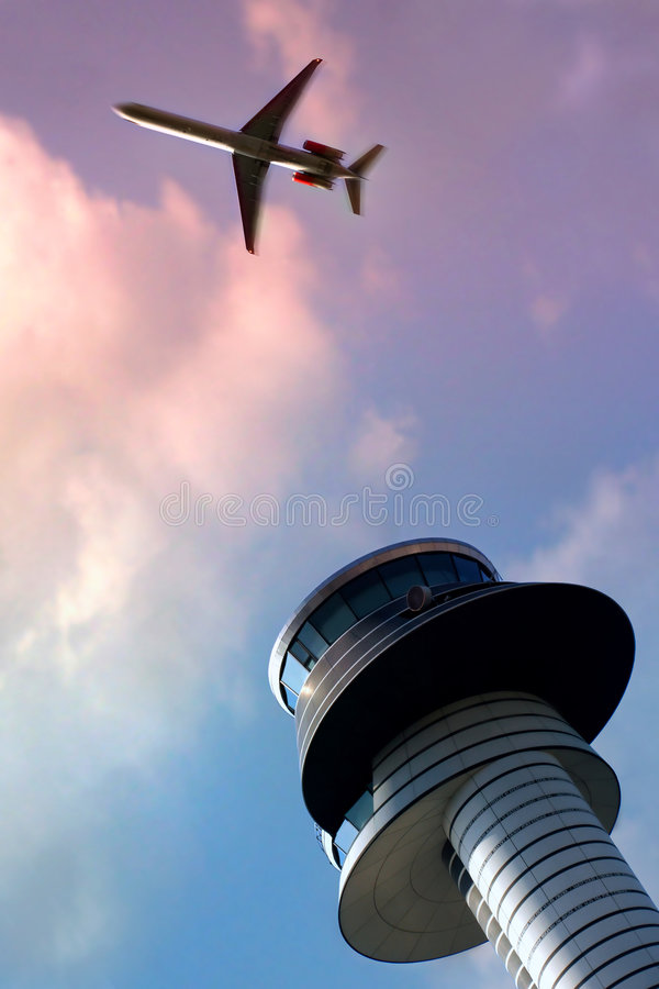 Air traffic control tower. And a plane royalty free stock photos