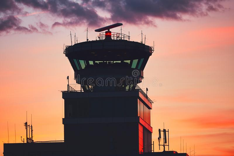 Air Traffic Control Tower. At the airport during amazing sunset. Prague, Czech Republic royalty free stock photo