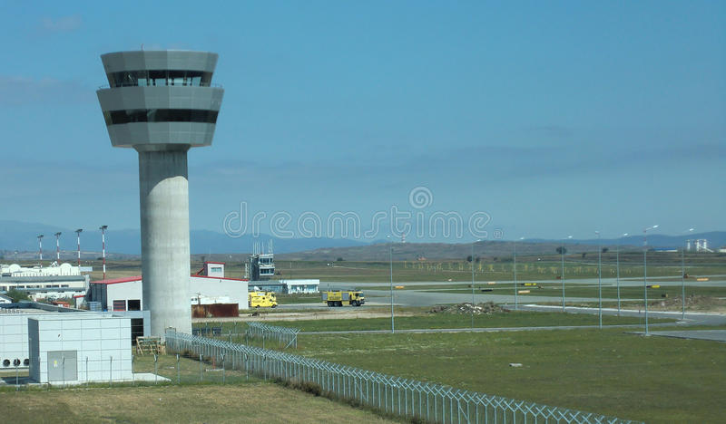 Air traffic control tower at Pristina International Airport in Kosovo. The control tower and field at the international airport in Pristina Kosovo royalty free stock photos