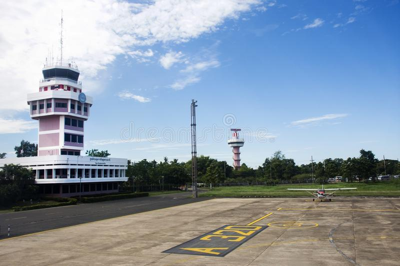Air Traffic Control tower and Small plane stop on runway at Ubon Ratchathani International Airport stock images
