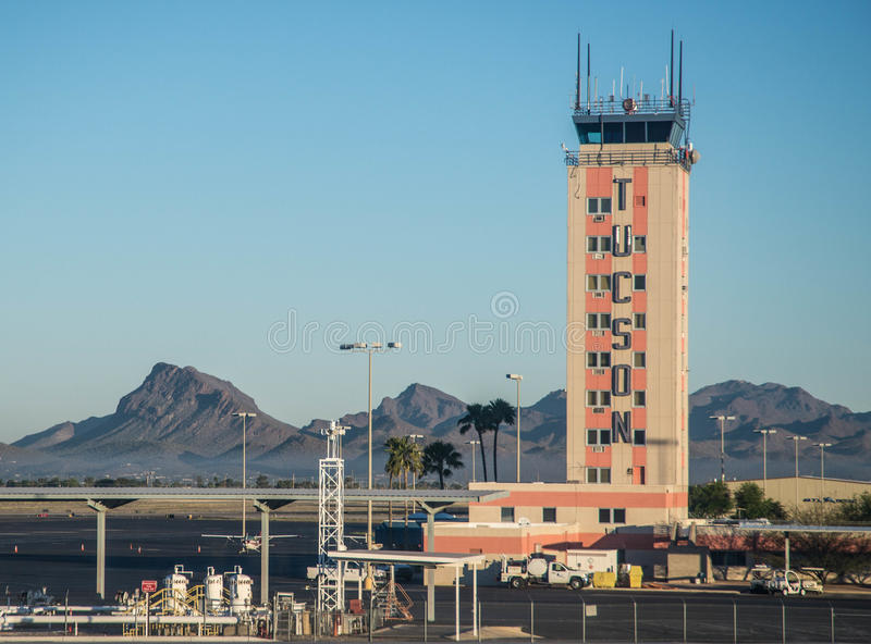 Air traffic control tower at the Tucson International Airport. Control tower and field at the airport in Tucson Arizona royalty free stock image