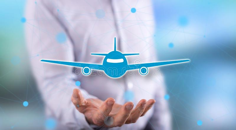 Concept of air transport. Air transport concept above the hand of a man in background stock photo