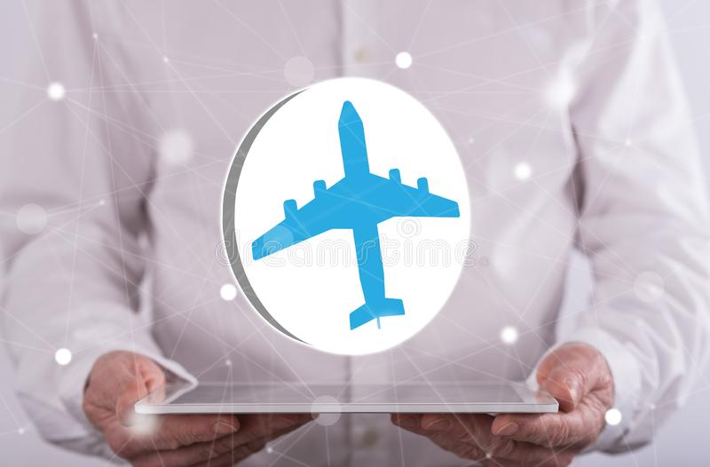 Concept of air transport. Air transport concept above a tablet held by a man in background royalty free stock image
