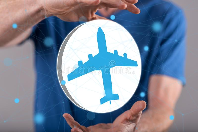 Concept of air transport. Air transport concept between hands of a man in background stock image