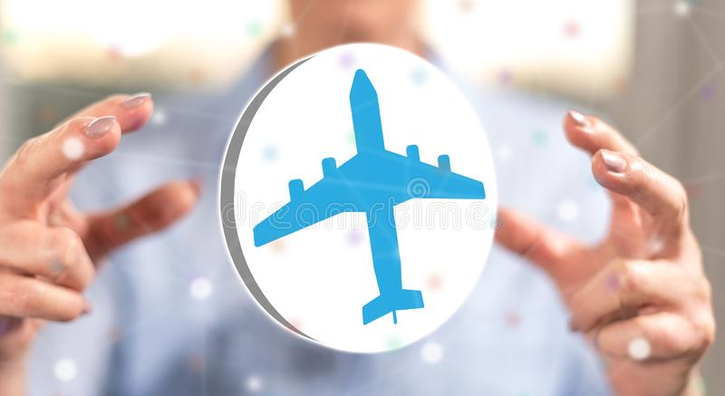 Concept of air transport. Air transport concept between hands of a woman in background royalty free stock photos