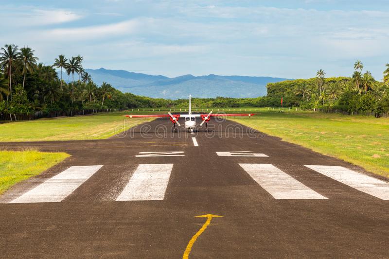 Air travel in Fiji, Melanesia, Oceania. A small propeller airplane just landed to a remote airstrip. Levuka town, Ovalau island. Air travel in Fiji, Melanesia royalty free stock photography