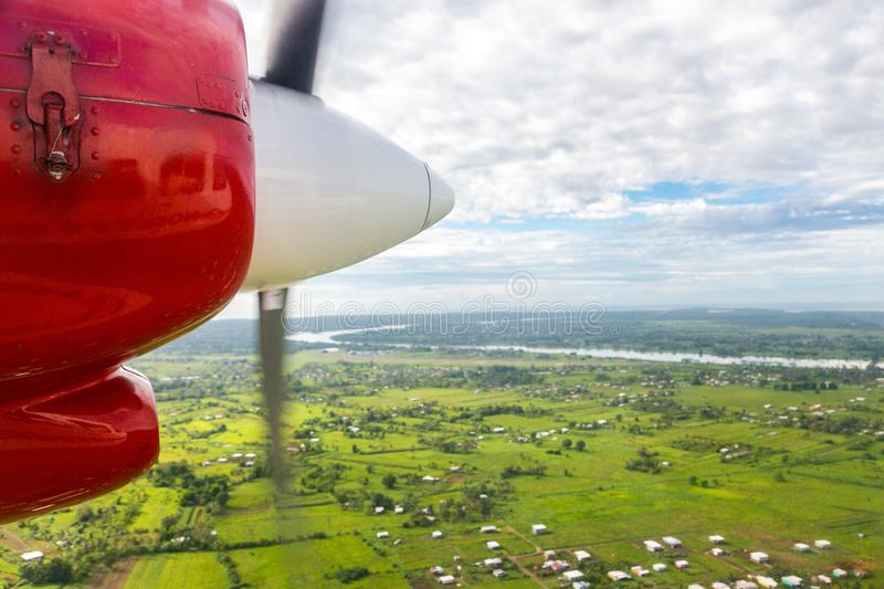 Air travel in Fiji, Melanesia, Oceania. View of Rewa river, Nausori town, Viti Levu island from a window of a small airplane. Air travel in Fiji, Melanesia stock photography