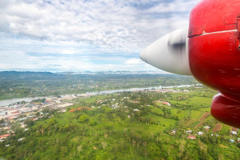Air travel in Fiji, Melanesia, Oceania. View of Rewa river, Nausori town, Viti Levu island from a window of a small red airplane. Air travel in Fiji, Melanesia stock photos
