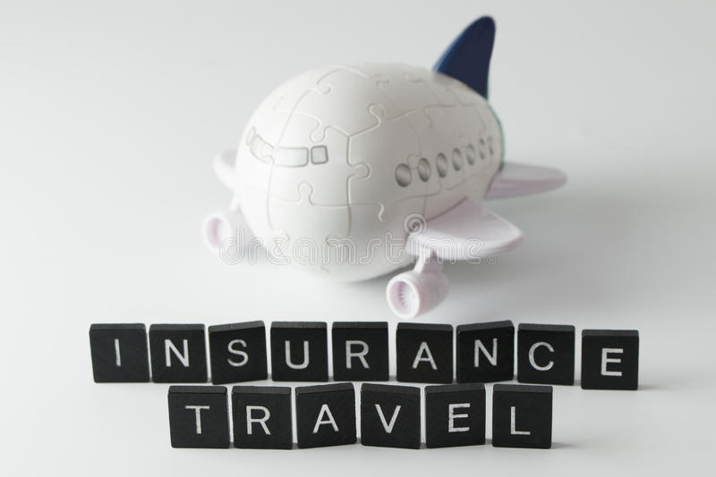 Air travel insurance. Air flight travel insurance word in front of 3D aeroplane puzzle stock images