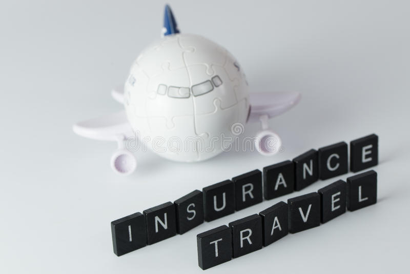 Air travel insurance. Air flight travel insurance word in front of 3D aeroplane puzzle royalty free stock photo