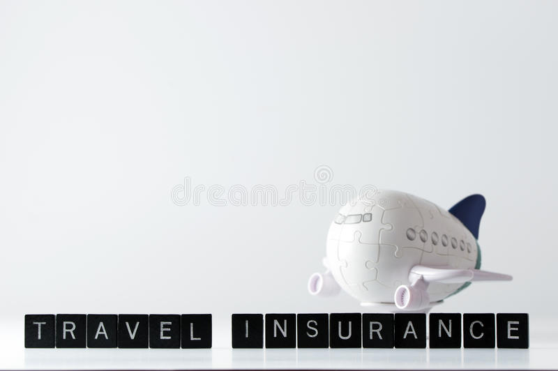 Air travel insurance. Air flight travel insurance word in front of 3D aeroplane puzzle stock image