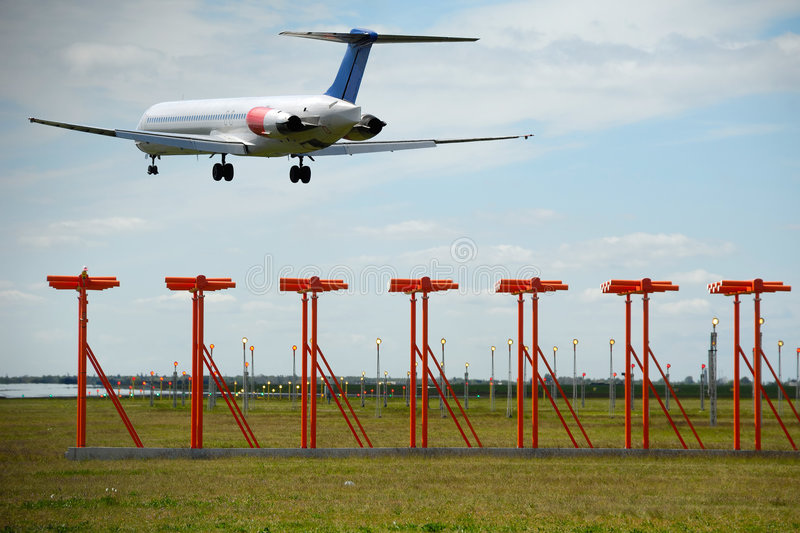 Air travel - Plane is landing in airport stock photo