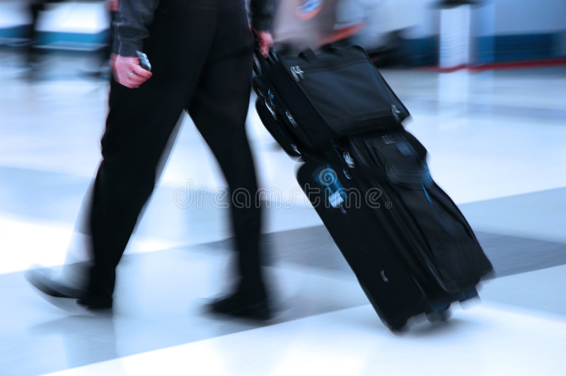 Air Traveler. Man rushing through an airport terminal stock photography