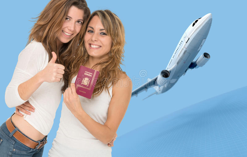 Air trip. Two happy female friends holding a passport by a flying airplane stock photography