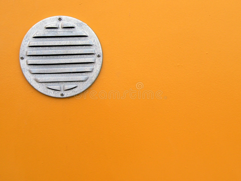 Air vent. On orange wall stock photos