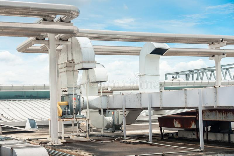 Air Ventilation Exhausting Blower and Chiller Pipe on Roofing Floor of Manufacturing Power Plant. Building Structure of Air. Conditioning Chiller Pipeline and royalty free stock photo