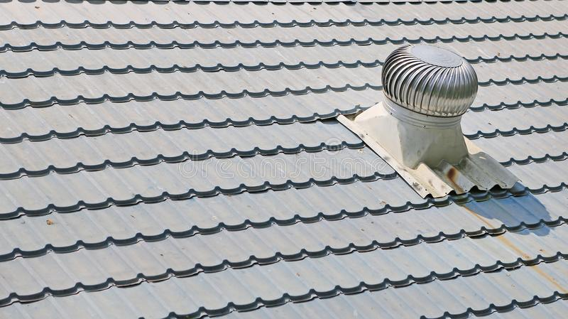 Air Ventilators on the rooftop spinning to take cool wind into house royalty free stock image