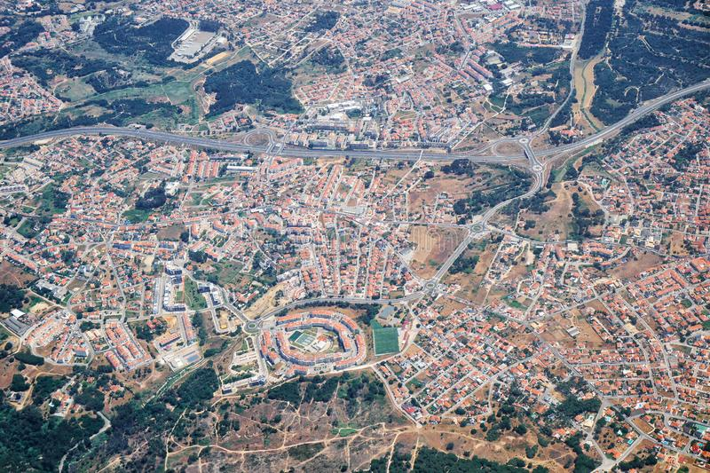 The air view of Almada. Portugal. The air view of Bem Me Quer condominium in the form of the eye in Charneca de Caparica parish. Almada. Portugal stock images