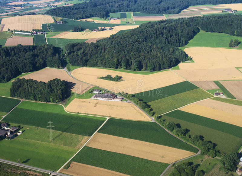 Air view on farm fields stock photography