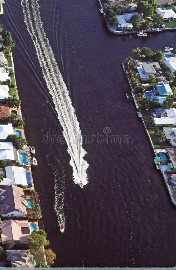 Intracoastal Waterway Florida. Air View of Intracoastal Waterway over Miami, Florida as two speed boats leave long wake waves stock images