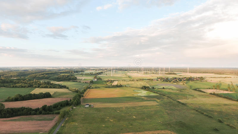 Air view of wind turbines fields and village royalty free stock image