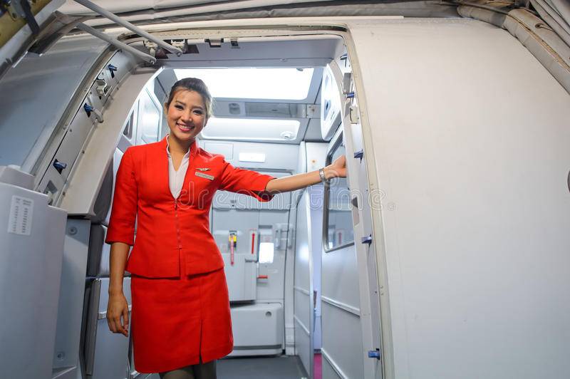 AirAsia crew member. SINGAPORE - NOVEMBER 07, 2015: AirAsia crew member on board of Airbus A320. AirAsia is a Malaysian low-cost airline headquartered near Kuala royalty free stock photo