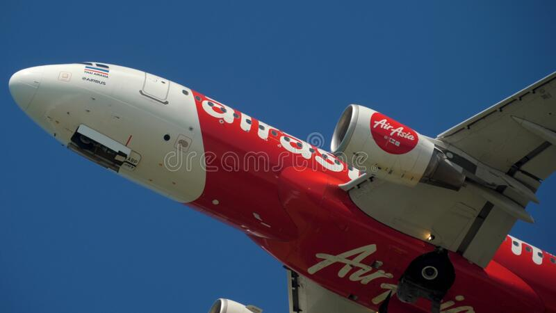 AirAsia departure from Phuket. PHUKET, THAILAND - NOVEMBER 12, 2019: Thai AirAsia Airbus A320 HS-ABP departure and climb, Phuket airport stock image