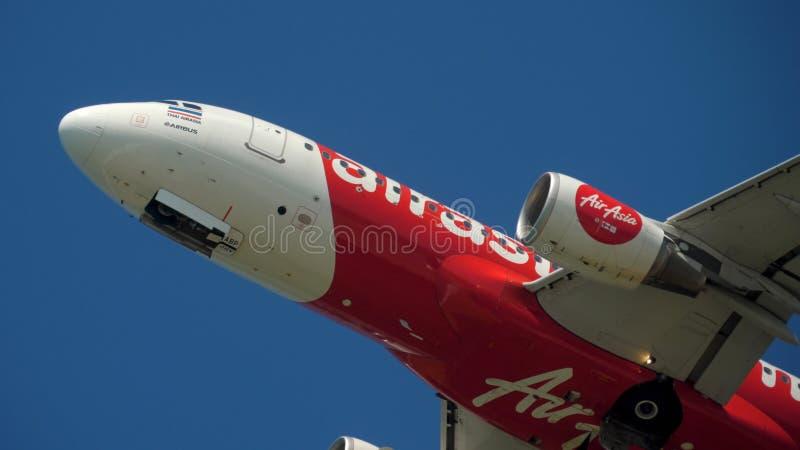 AirAsia departure in the sky. PHUKET, THAILAND - NOVEMBER 12, 2019: Thai AirAsia Airbus A320 HS-ABP departure and climb, Phuket airport stock photos