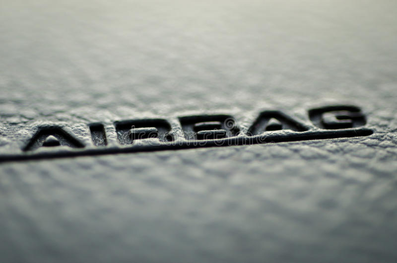 Airbag. Closeup airbag text under warm light royalty free stock images