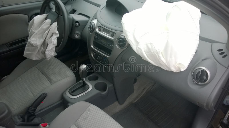 Airbag in crashed black car stock images