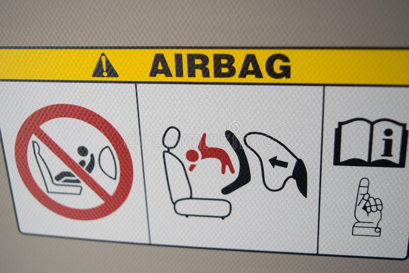 Airbag plate warning in city car, on sunshade. Of white car royalty free stock photography