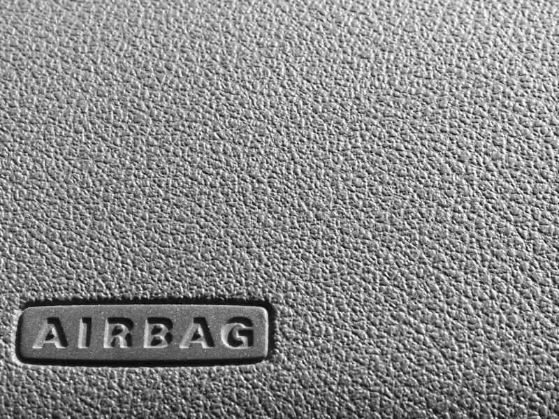 Airbag sign on a dashboard. Macro of an airbag sign on a dashboard royalty free stock image