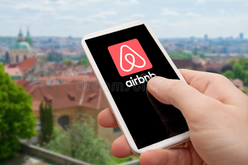 Airbnb - using the mobile app stock photography
